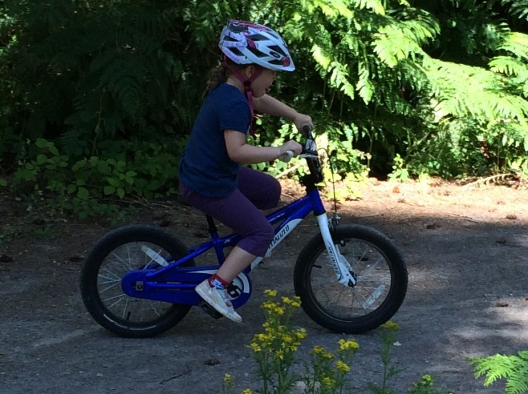 My daughter tearing up the bike tracks at Alice Holt